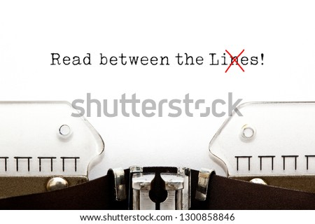 Text Read Between The Lies typed on vintage typewriter. The usually used word in the original idiom Lines is changed to Lies. Royalty-Free Stock Photo #1300858846