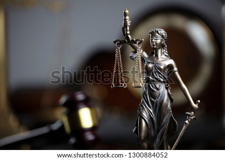 Law and justice concept. Judge's gavel, scales, hourglass, vintage clock, books. #1300884052