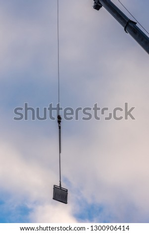 The railing at the hook of the crane #1300906414