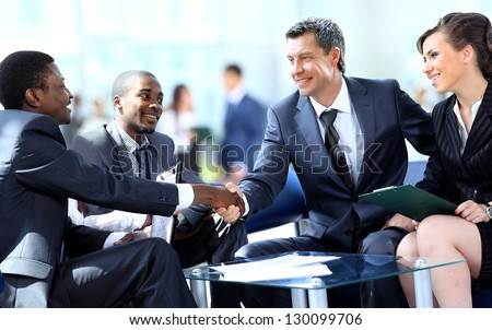 Business people shaking hands, finishing up a meeting #130099706