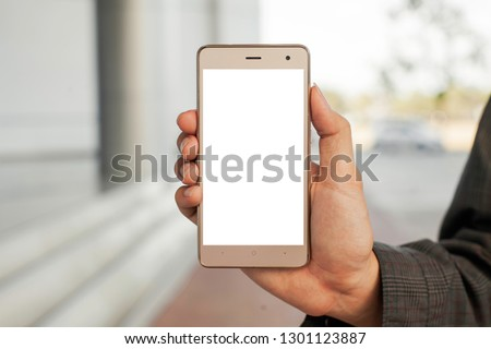 Smartphone and blurred background #1301123887