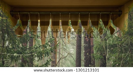 Clothes hanger with dresses in the forest. Concept for organic clothes, closet and sustainable fashion. #1301213101