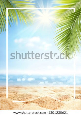 Summer background with frame, nature of tropical golden beach with rays of sun light and leaf palm. Golden sand beach close-up, sea,  blue sky, white clouds. Copy space, summer vacation concept. #1301230621