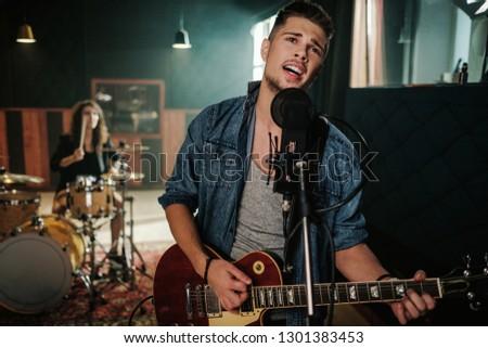Music band having rehearsal in a studio #1301383453