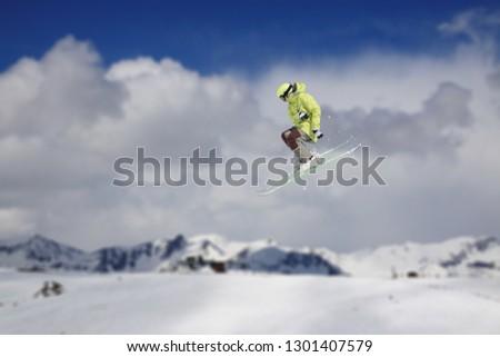 Flying skier on snowy mountains. Extreme winter sport, alpine ski. #1301407579