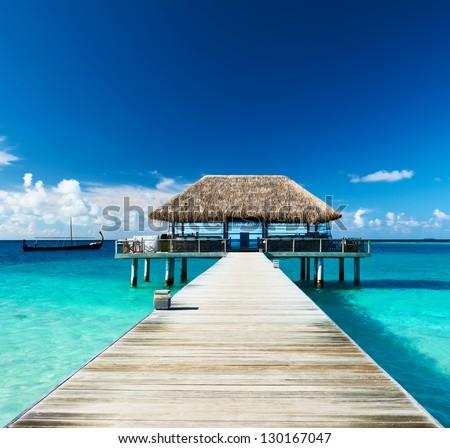 Beautiful beach with jetty at Maldives #130167047