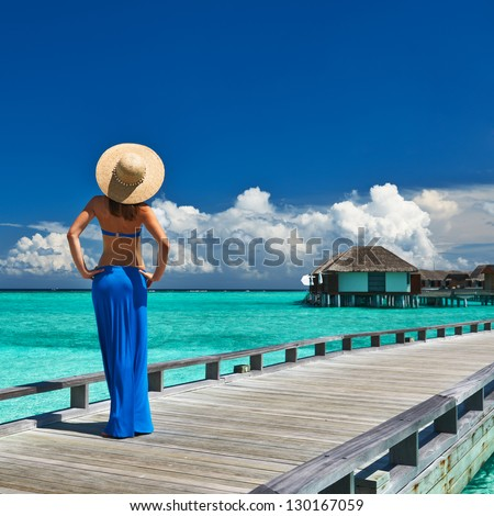 Woman on a tropical beach jetty at Maldives #130167059