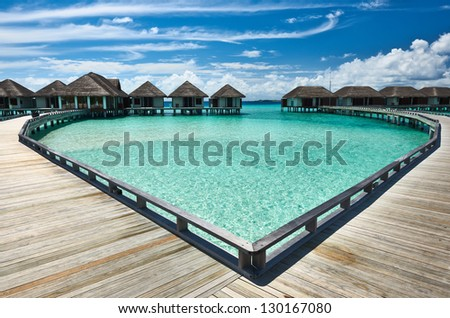 Beautiful beach with water bungalows at Maldives #130167080