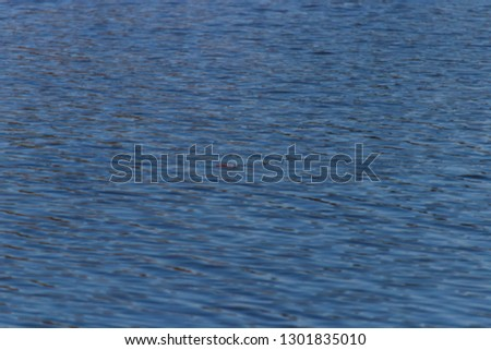A close up of rippling water from a body of water. #1301835010