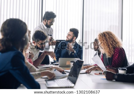 Caucasian businessman takes advice to Indian financial advisor during meeting with his strategic partners at his office #1302108637