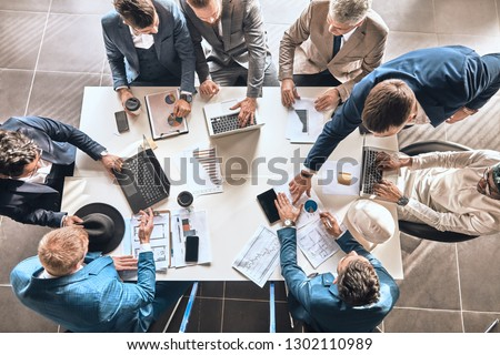 successful partners are sharing experience in the office roo, top view photo #1302110989