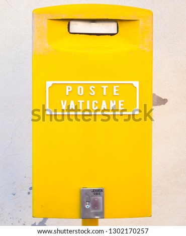 ROME, VATICAN STATE - AUGUST 19, 2018: Detail of the traditional yellow post box in Vatican City, Rome #1302170257