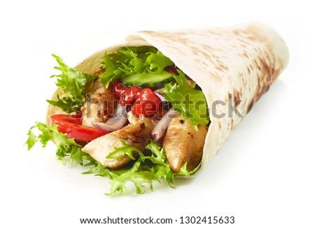 Tortilla wrap with fried chicken meat and vegetables isolated on white background Royalty-Free Stock Photo #1302415633