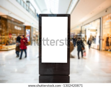 Digital media blank black and white screen modern panel, signboard for advertisement design in a shopping centre, gallery. Mockup, mock-up, mock up with blurred background, digital kiosk. #1302420871