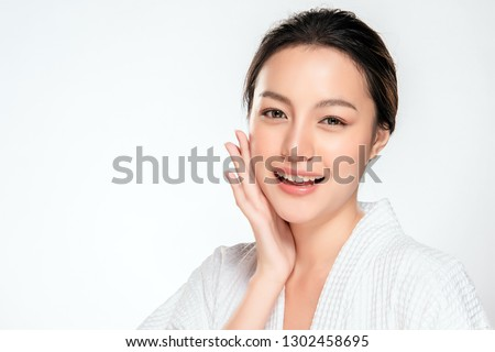Beautiful Young asian Woman with Clean Fresh Skin look. Girl beauty face care. Facial treatment. Cosmetology, beauty and spa. #1302458695