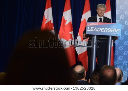 London, Ontario / Canada - August 18, 2015: Prime Minister Stephen Harper speaks during a campaign event at the Lamplighter Inn in London, Ontario.  #1302523828