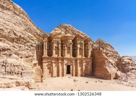 Famous facade of Ad Deir in ancient city Petra, Jordan. Monastery in ancient city of Petra. The temple of Al Khazneh in Petra is one of UNESCO World Heritage Sites an #1302526348