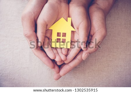 hands holding paper house, family home, homeless shelter and real estate, housing and mortgage crisis, foster home care, family day care, social distancing #1302535915