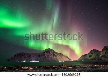 Aurora Borealis at Skagsanden beach Lofoten islands Norway #1302569395
