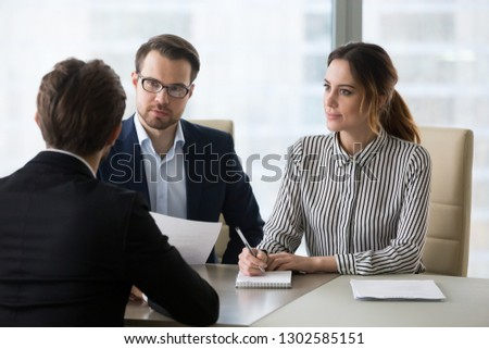 Professional hr recruiting company managers holding resume interviewing job applicant, employers recruiters listen seeker at interview make hiring decision at employment negotiation, staffing concept #1302585151