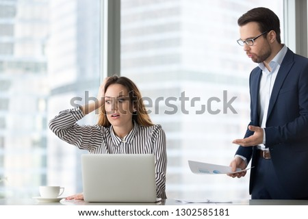 Angry boss scolding terrified stressed lazy female worker for bad work, shocked confused incompetent silly secretary forgot missed deadline worried about mistake in financial report or duties failure #1302585181