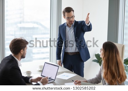 Rude angry boss executive demanding to leave meeting dissatisfied irritated by female colleague, mad annoyed businessman firing businesswoman employee as gender discrimination and harassment concept #1302585202