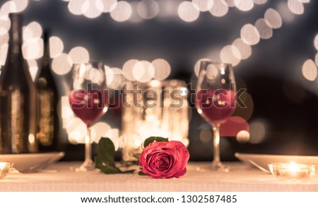 Valentines dinner romantic love concept. Romantic table setting  with wine glass roses with candlelight. #1302587485