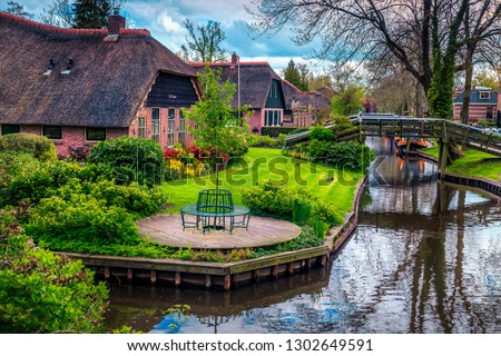 Famous romantical travel destination. The best visited touristic European village with traditional dutch houses and ornamental gardens, Giethoorn, Netherlands, Europe #1302649591