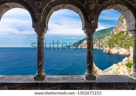 Grotta di Lord Byron, coast with rock cliff through external arch colonnade Church San Pietro, Portovenere, Ligurian sea, Riviera di Levante, National park Cinque Terre, La Spezia, Liguria, Italy Royalty-Free Stock Photo #1302671212