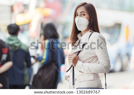 Asian woman are going to work.She is wearing a mask N95. To prevent dust, pm 2.5 #1302689767