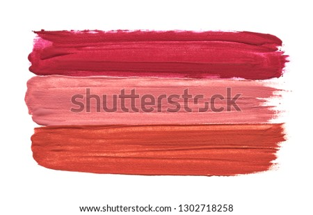 Three straight lines made by three different lipsticks isolated on white background. Lipstick texture isolated on white background #1302718258