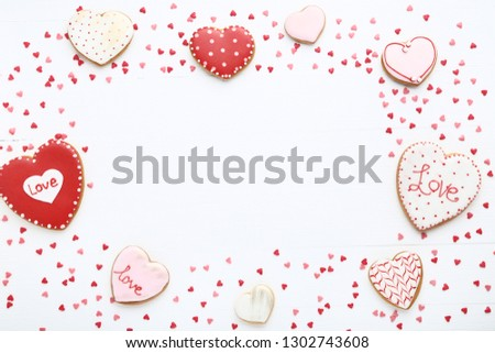 Valentine day cookies with heart shaped sprinkles on white wooden table #1302743608
