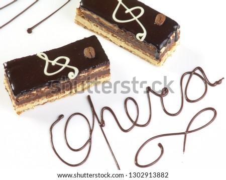Musical dessert. Biscuit cake with chocolate decoration. #1302913882
