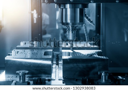 The CNC milling machine cutting the mould part with the index-able radius end mill tool in roughing process.The  operation of CNC milling machine .The CNC milling #1302938083
