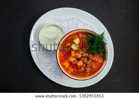hot soup with broth and stew with vegetables #1302951853