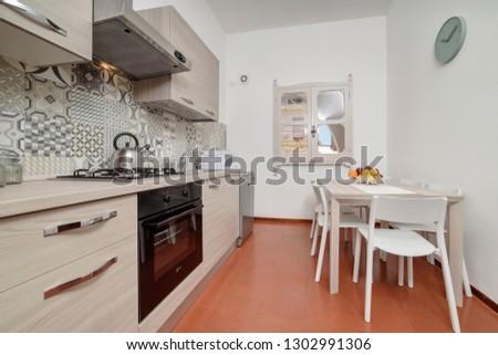 Italy, Sicily, Kaukana (Ragusa Province); 5 June 2018, house kitchen and dining table - EDITORIAL #1302991306
