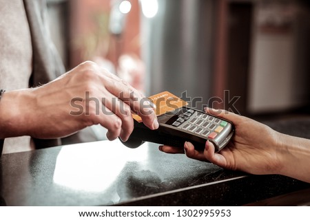 Well done. Close up of female hand that giving terminal for online payment #1302995953