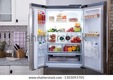 An Open Refrigerator Filled With Fresh Fruits And Vegetables #1303093705