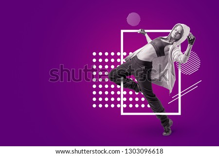 A young beautiful female dancer in sleeveless crop top, sweatpants and hoodie dancing on a purple background with white circular and rectangular shapes. Live to dance, dance to live. Youth subcultures