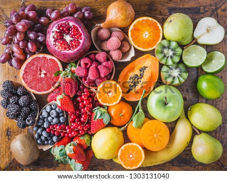 Fruits and berries rainbow top view.Natural vitamins and antioxidants food concept. #1303131040