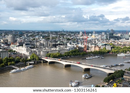Thames river and city buildings in London in cloudly day, United Kingdom #1303156261