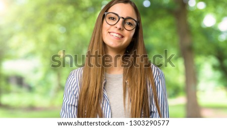 Young girl with striped shirt with glasses and happy at outdoors #1303290577