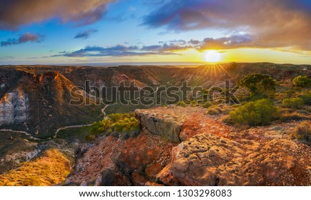 panorama view of sunrise over charles knife canyon near exmouth, western australia Royalty-Free Stock Photo #1303298083