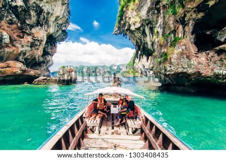 Krabi, Thailand - 26 December 2018 : Tourists enjoy beach scenery in krabi #1303408435