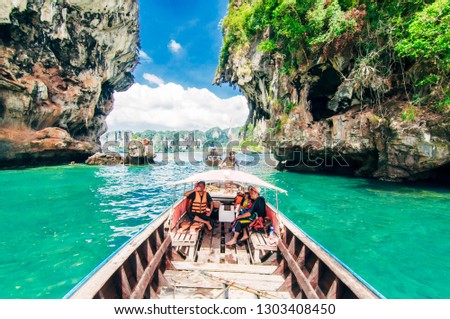 Krabi, Thailand - 26 December 2018 : Tourists enjoy beach scenery in krabi #1303408450