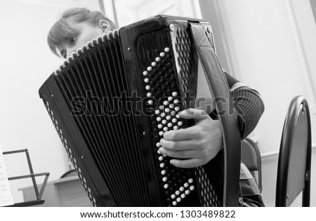 young woman playing accordion, close up #1303489822