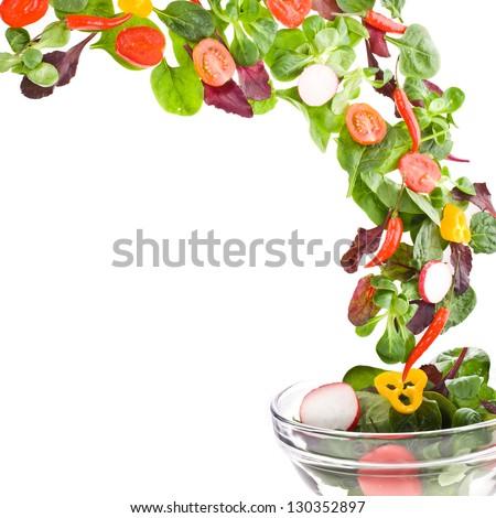 Flying  fresh salad isolated over white background #130352897