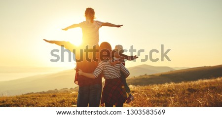 Happy family: mother, father, children son and  daughter on nature  on sunset #1303583569