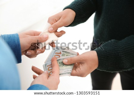 Woman buying drugs from dealer. Concept of addiction #1303593151