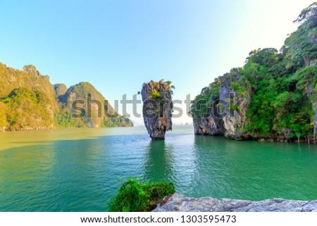 James Bond island near Phuket in Phang Nga bay in Thailand #1303595473